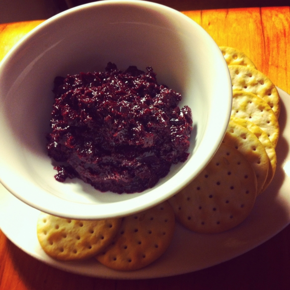 Beetroot, roast garlic & sumac dip in a bowl with crackers