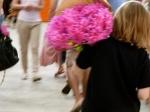 Girl carrying dahlias through Eveleigh Markets