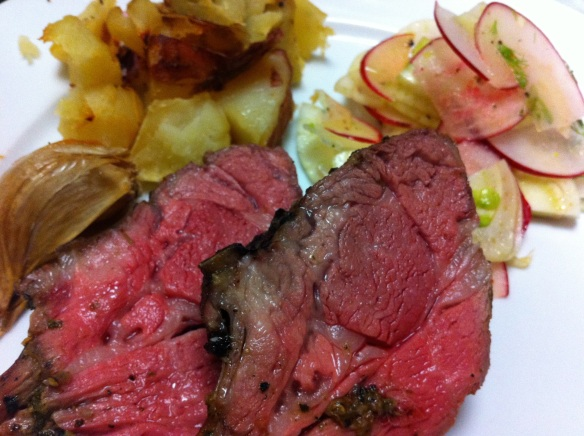 greek-style slow roast lamb rack served with roast potatoes and radish and fennel salad