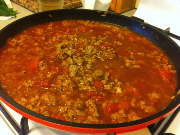 bolognese sauce cooking on the stove