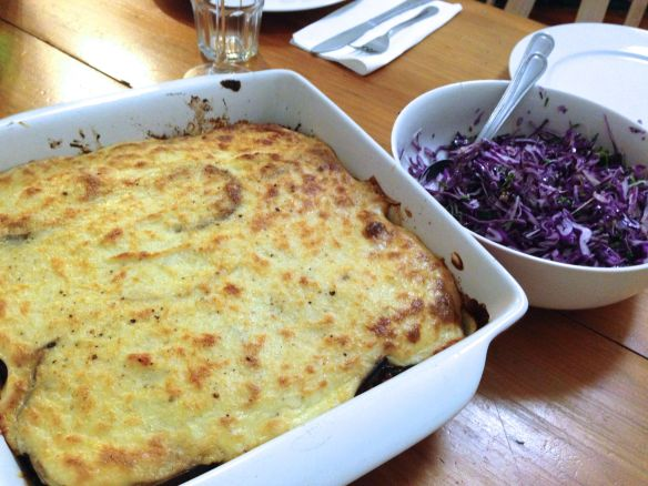 Baked moussaka and red cabbage salad